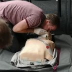 Man learning to give first aid